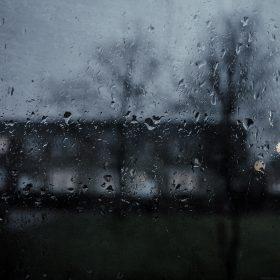mi63-good-to-stay-home-dark-rainy-window